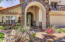 Front Elevation Features Custom Rock Work, Custom Built Arches & Gorgeous Custom Built Canterra Door