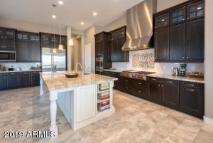 Gorgeous Kitchen with WOLF cooktop, double ovens, microwave, potfiller.