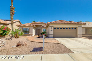 Beautiful home with desert landscaping and paver's
