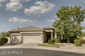 3 car garage single level with golf course behind the home