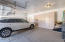 Large 3 Car Garage with storage cabinets