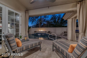 Heated Pool and Spa features falling water as well as fire table.