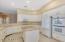 Kitchen features 2 ovens, granite center island, white applicances