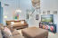 Vaulted ceilings, soft blue and grey paint tones.