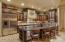 The gourmet cook's kitchen features huge center island and furniture grade cabinetry throughout.