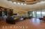 Office features built in bookcases and gorgeous wood flooring.