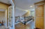 Hard wood floors in upstairs hallway connecting loft, bedrooms and bathroom