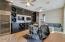Custom wine / game room + 2 full height refrigerators, 2 TV's to watch your favorite games and 3/4 bath!