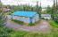 Warehouse with mezzanine, overhead door for large truck on one end and slider wall on other. Third 500 sf cabin by lake.