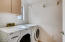 Laundry Room features sink, cabinets and washer/dryer.