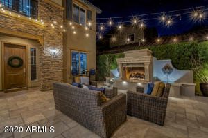Stunning courtyard with water features and a gas fireplace.