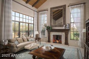 Enveloped in a generous helping of paned glass, the family room is featured in the best of ways....