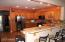 Main Family Area overlooks kitchen but separated from activites.