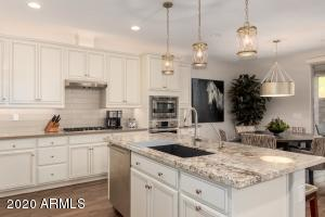 GAS COOKTOP AND ISLAND SINK counters are Quartz & granite