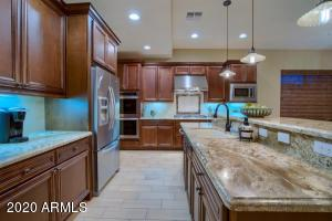 Well-appointed kitchen includes a coffee or appliance bar and loads of counter space