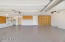 3 Car Garage with Epoxy Floors, Built-In Cabinets , Water Softener and Storage Room