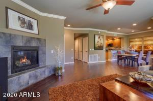 Gas fireplace and crown molding throughout.