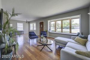 Cherry Wood Floors welcome you to this warm and inviting classic ranch style home with charming bay windows in both living and formal dining areas.