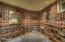 Room for over 600 bottles including large magnum and collectible displays in this professionally installed wine room, with accent lighting. chilled with cubicles for all size bottles in your collection.