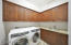 Ample cabinet space and laundry sink.