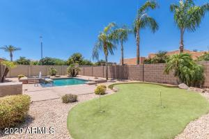 Heated Pool, Spa and putting green in your spacious backyard