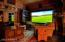 Great Room's drop-down projection screen provides perfect movie viewing.