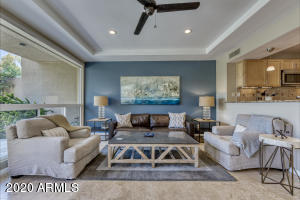 Bright great room opens to both kitchen and back patio for carefree living