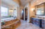 Master bath with remote blinds, dual vanities & closets