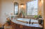 Jetted tub with secluded mountain views