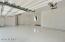 3 Car Garage w/ Epoxy Floor & Built in Cabinets