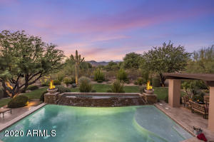 Enjoy this resort style backyard complete with refreshing pool, Pergola, outdoor kitchen, and mountain views.