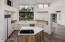 Imagine cooking on the stove in this newly remodeled kitchen looking out to Pinnacle Peak