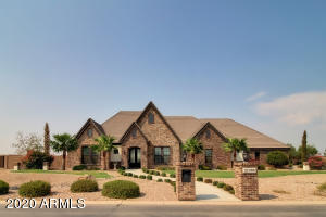 Gorgeous custom made home. Corner lot at Pegasus Airpark, on east end of the runway.