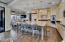 Huge kitchen island with a breakfast bar and custom storage all around.