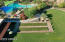 Mita Clubhouse with bocce ball courts, lawn & pool