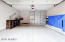 2 car garage with epoxy floors and built in cabinets