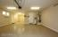 3 CAR TANDEM HEATED & COOLED GARAGE W/ SPOTLESS EPOXY FLOORS & NEW WATER SOFTNER