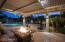 Patio with retractable patio cover.