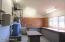 Vaulted ceiling garage has full workshop with storage & sink