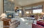 Open to kitchen with entertainment wall and stone fire place