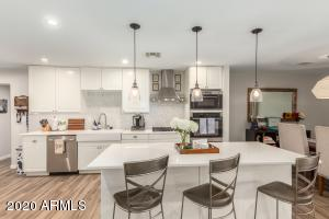 *Open + Gorgeous! Large kitchen w/ quartz counters, white shaker cabinets, marble backsplash, SS appliances, large island + pendant lighting - Classic and Modern*