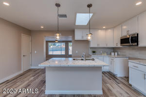 don't miss the beautiful granite countertops and tile backsplash!