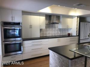 Completely refreshed kitchen with new cabinet door & drawer faces, refinished cabinet interiors, many new appliances, new lighting fixture in recess, new faucet, new countertops, new backsplash and island tile surround...