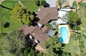 Beautiful 14,000 SQ. FT. corner lot with Irrigation. Tree in front of house has recently been removed.