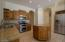Granite counters & high end maple kitchen cabinetry.