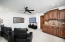 Game/Theatre room with wet bar, beverage fridge and sink.