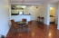 Easy care wood-tone laminate flooring and open floor plan