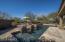 Raised deck behind pool