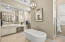 Master bath with his/her vanities, his/her commodes, soaking tub, 2-sided shower