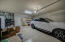 Spacious 3 car garage with Built in cabinets